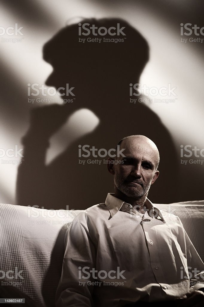 Senior man lost in thought royalty-free stock photo