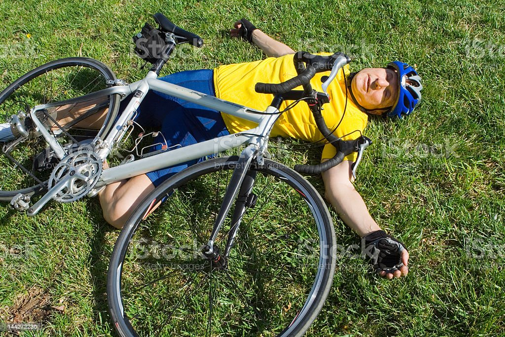 Senior Man Lying on the Ground After a Bike Accident royalty-free stock photo