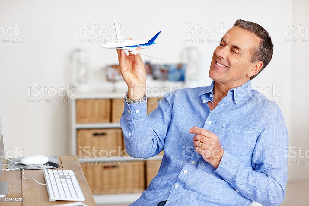 Senior man making plans for traveling during his retirement royalty-free stock photo