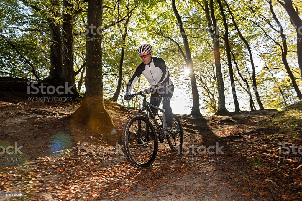 Senior Man Mountain Biking at Møns Klint Denmark stock photo