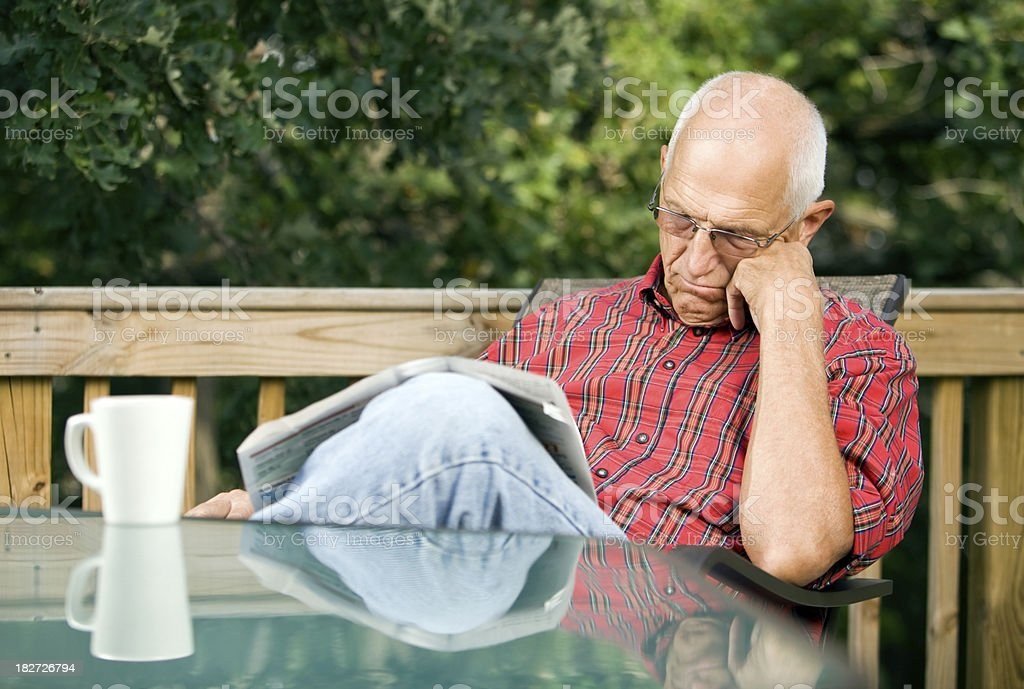 Senior Man Napping on a Deck with Wooded Background royalty-free stock photo