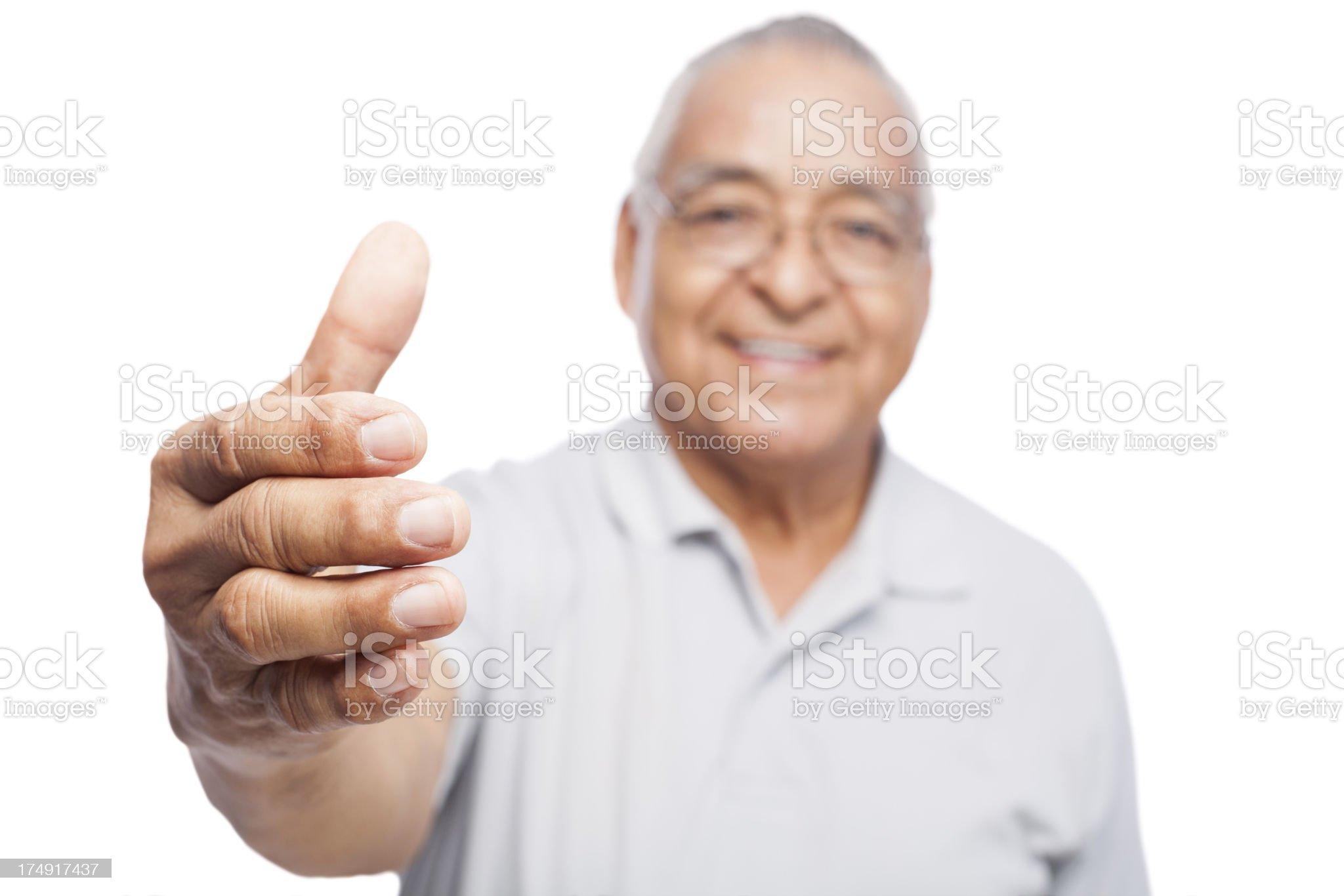 Senior man offering a handshake royalty-free stock photo