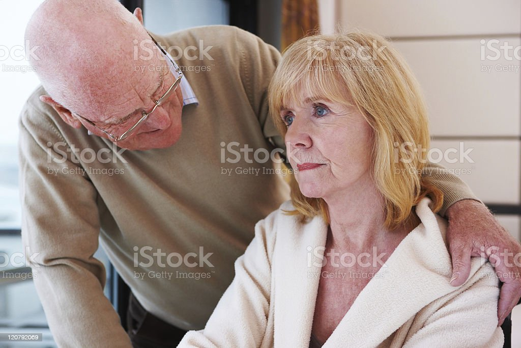 Senior Man Offering Comfort stock photo