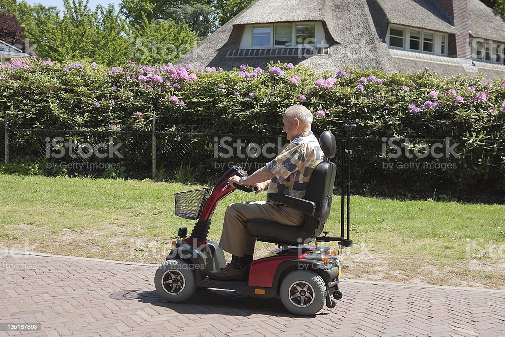 senior man on a mobility scooter stock photo