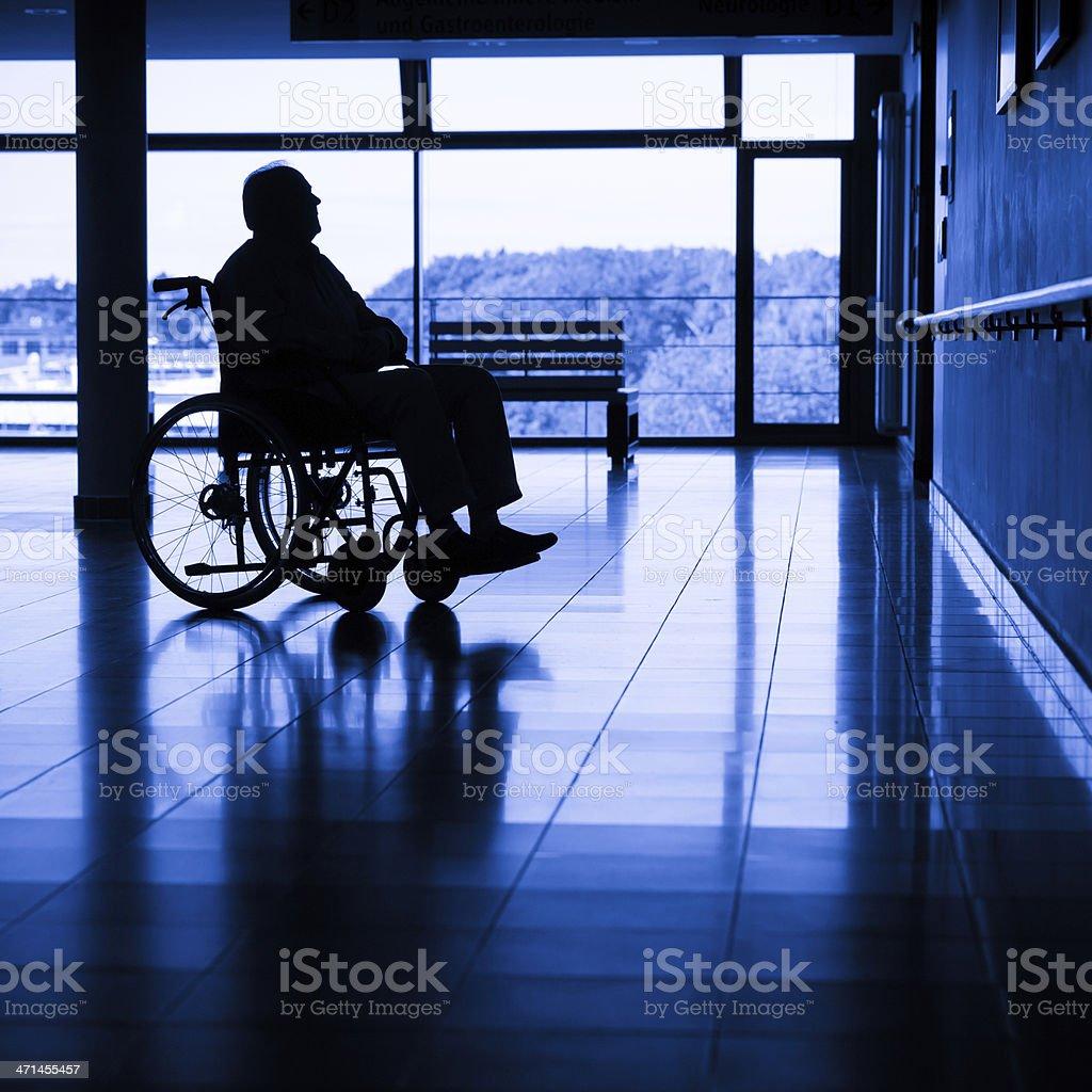 Senior man on a wheelchair royalty-free stock photo