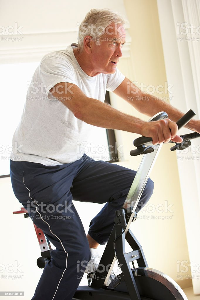 Senior Man On Exercise Bike royalty-free stock photo