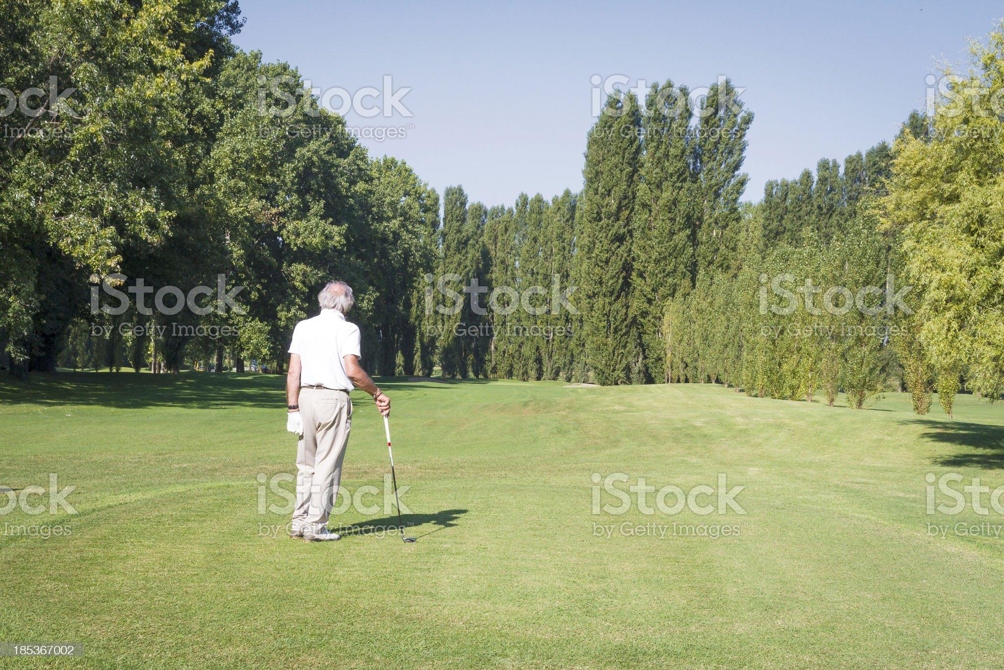 Senior man on golf course royalty-free stock photo