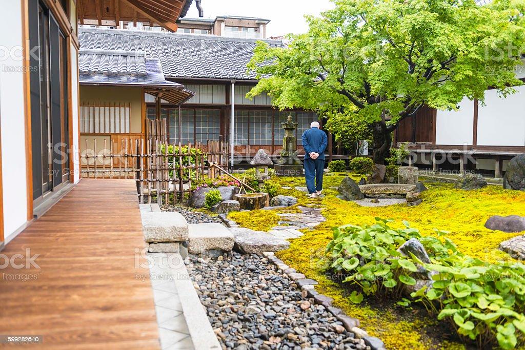 Senior man on temple garden stock photo