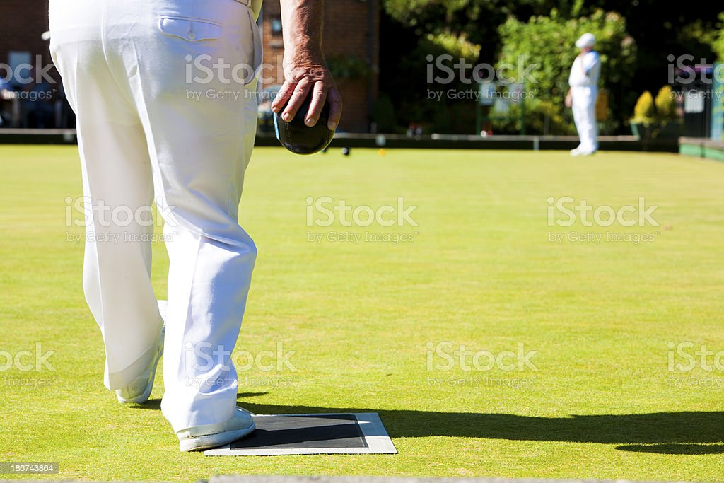 Senior man on the grass bowling green stock photo
