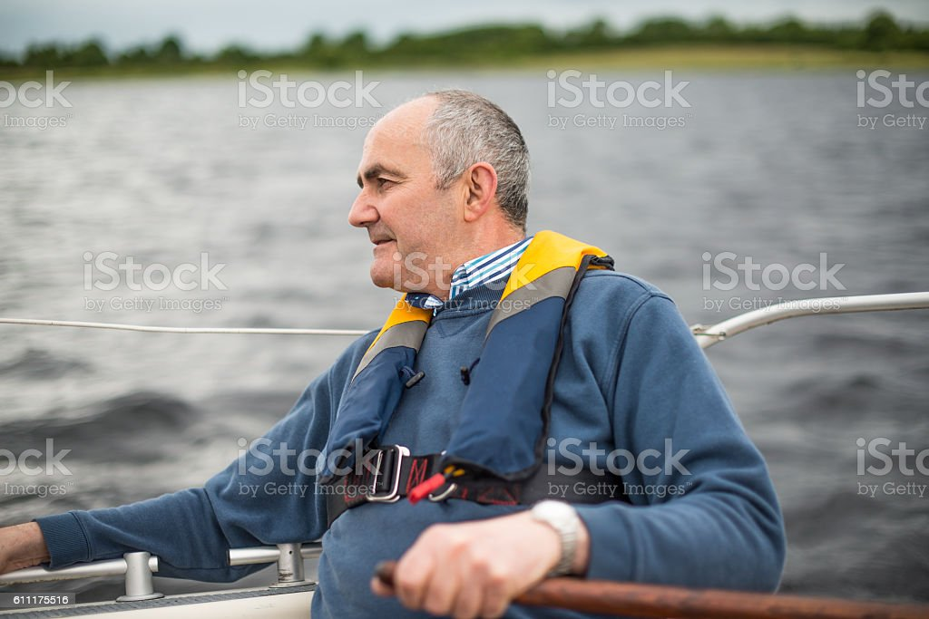 Senior man on the open waters stock photo