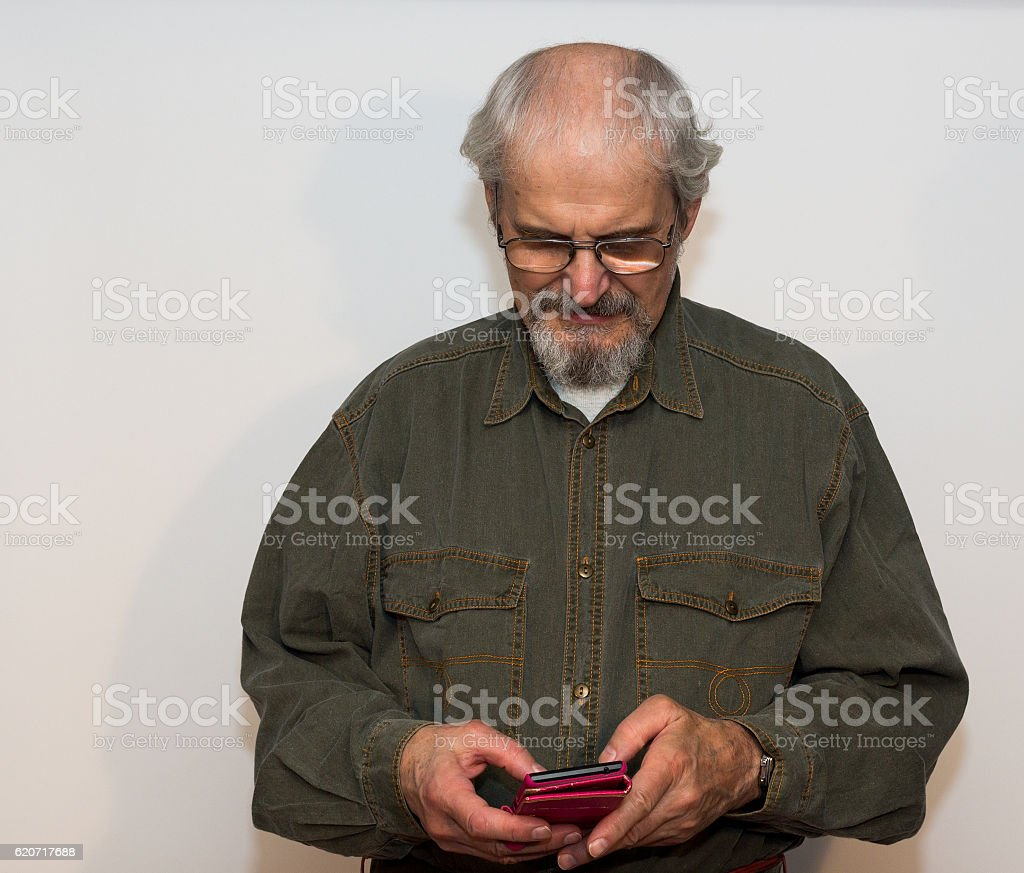 Senior man on the texting. royalty-free stock photo