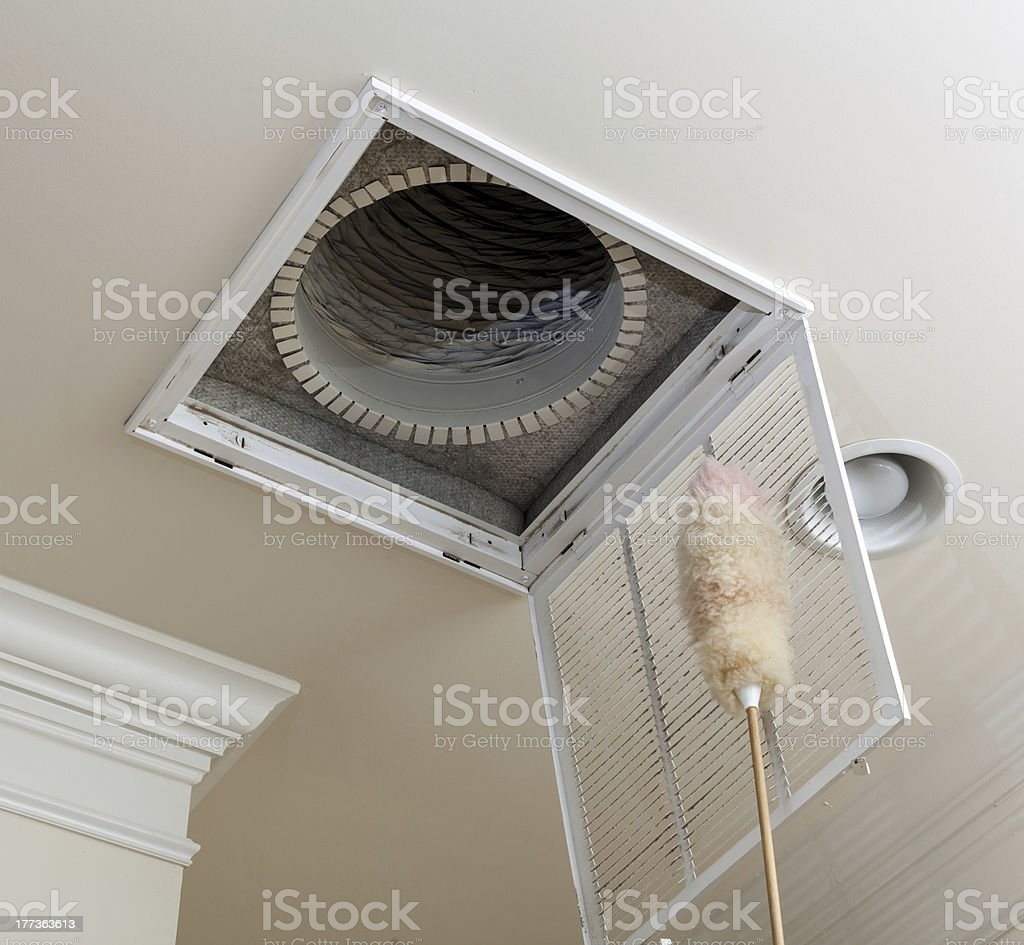 Senior man opening air conditioning filter in ceiling stock photo