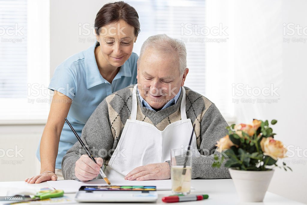 Senior man painting royalty-free stock photo