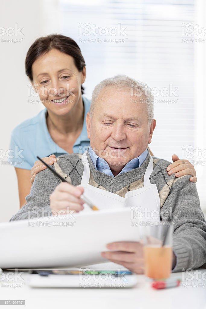 Senior man painting royalty-free stock photo