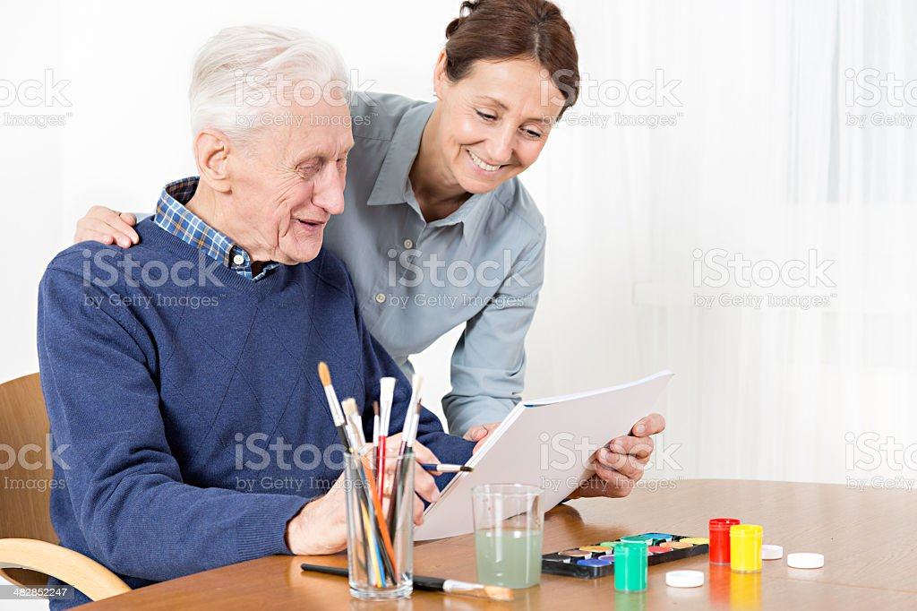 Senior man painting stock photo