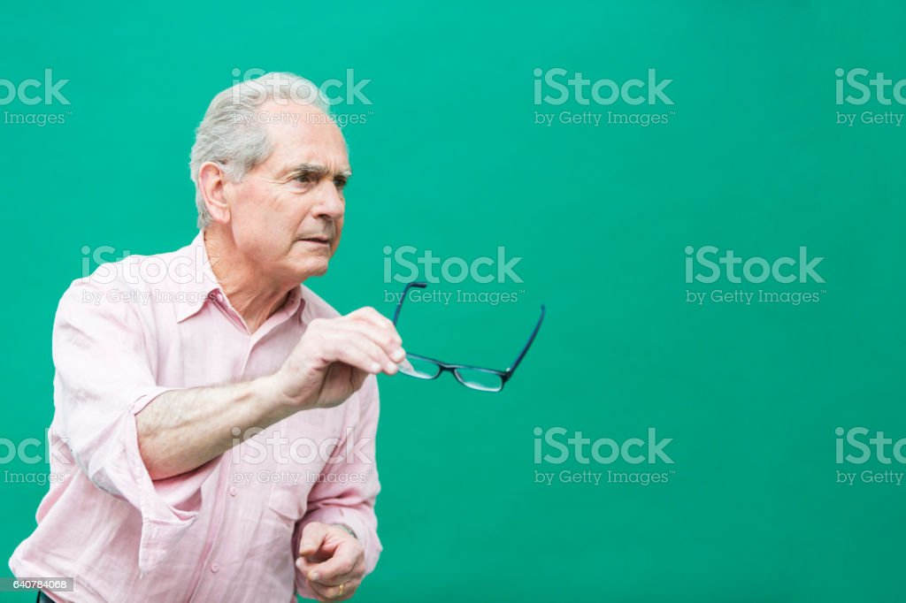 Senior Man Passing His Glasses stock photo