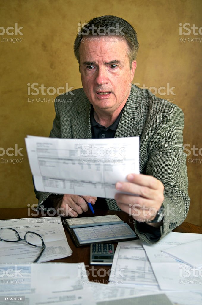 Senior Man Paying Bills royalty-free stock photo