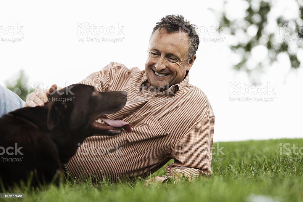 Senior Man Petting His Dog Outdoors royalty-free stock photo