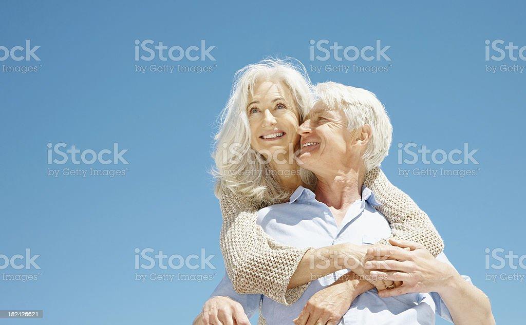 Senior man piggybacking his wife royalty-free stock photo