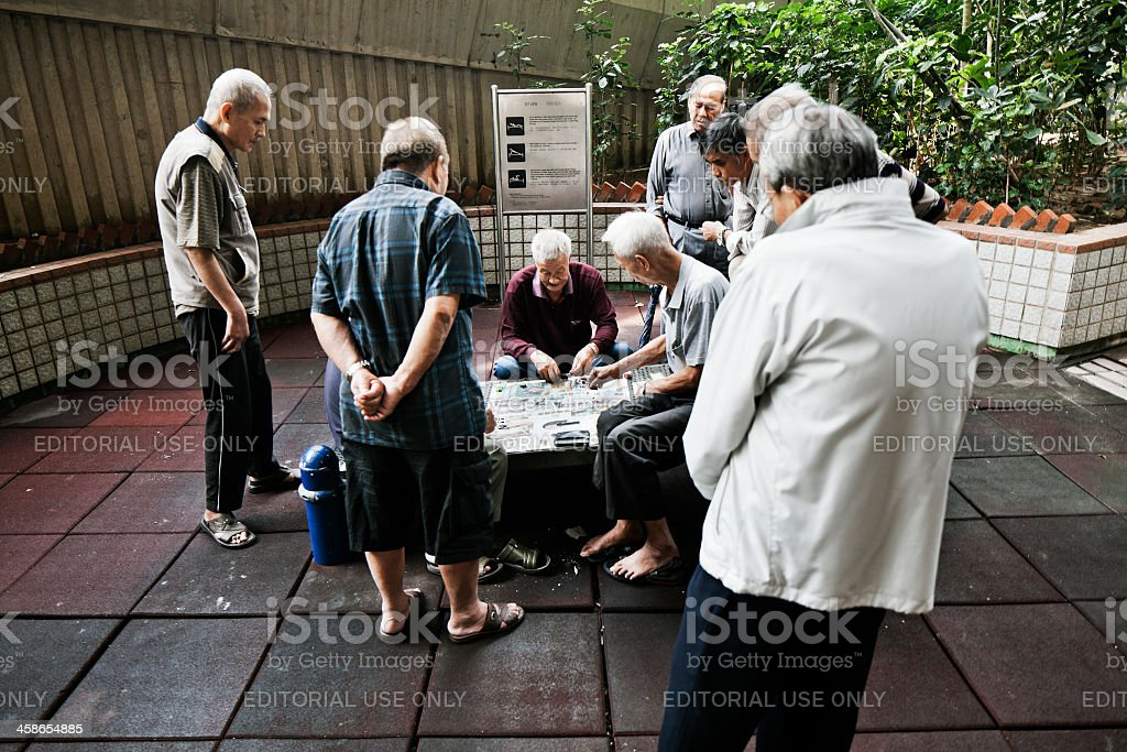 Senior man playing cards stock photo