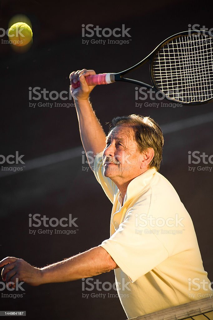 Senior man playing tennis royalty-free stock photo