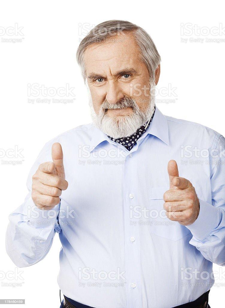 Senior man pointing at viewer royalty-free stock photo
