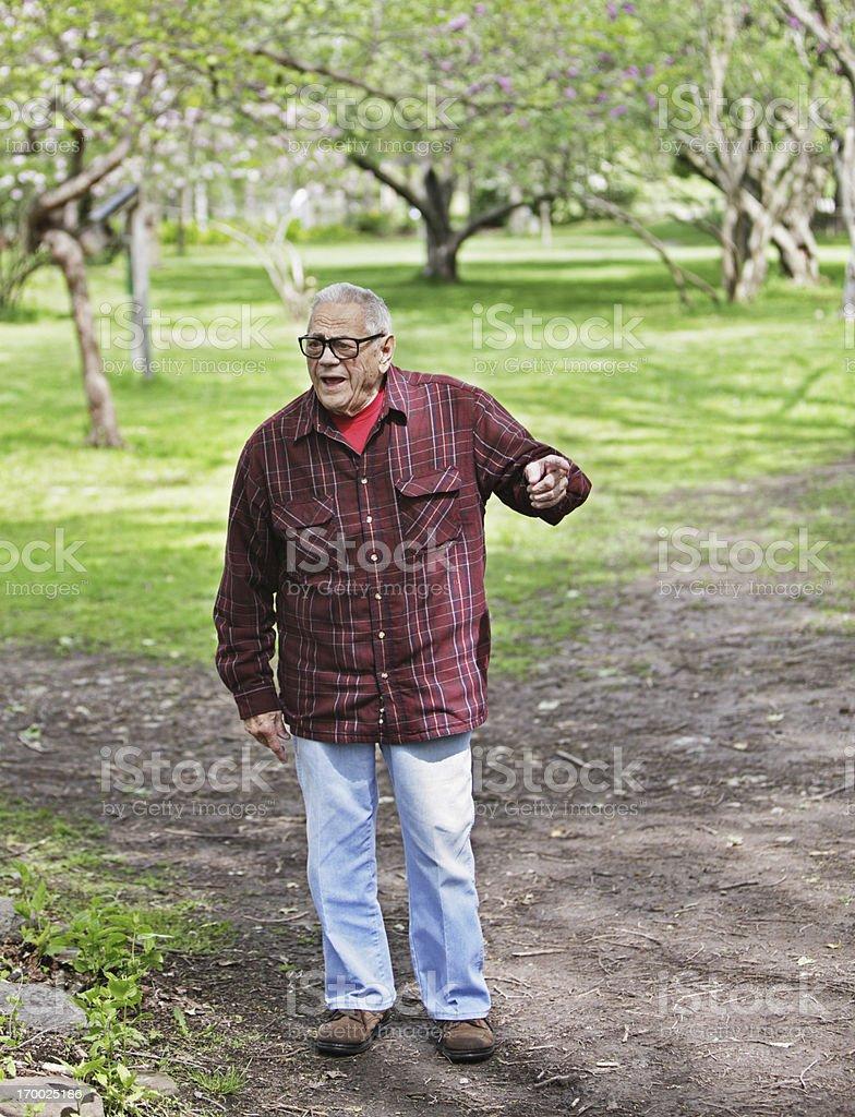 Senior Man Pointing Finger at Nature Park stock photo