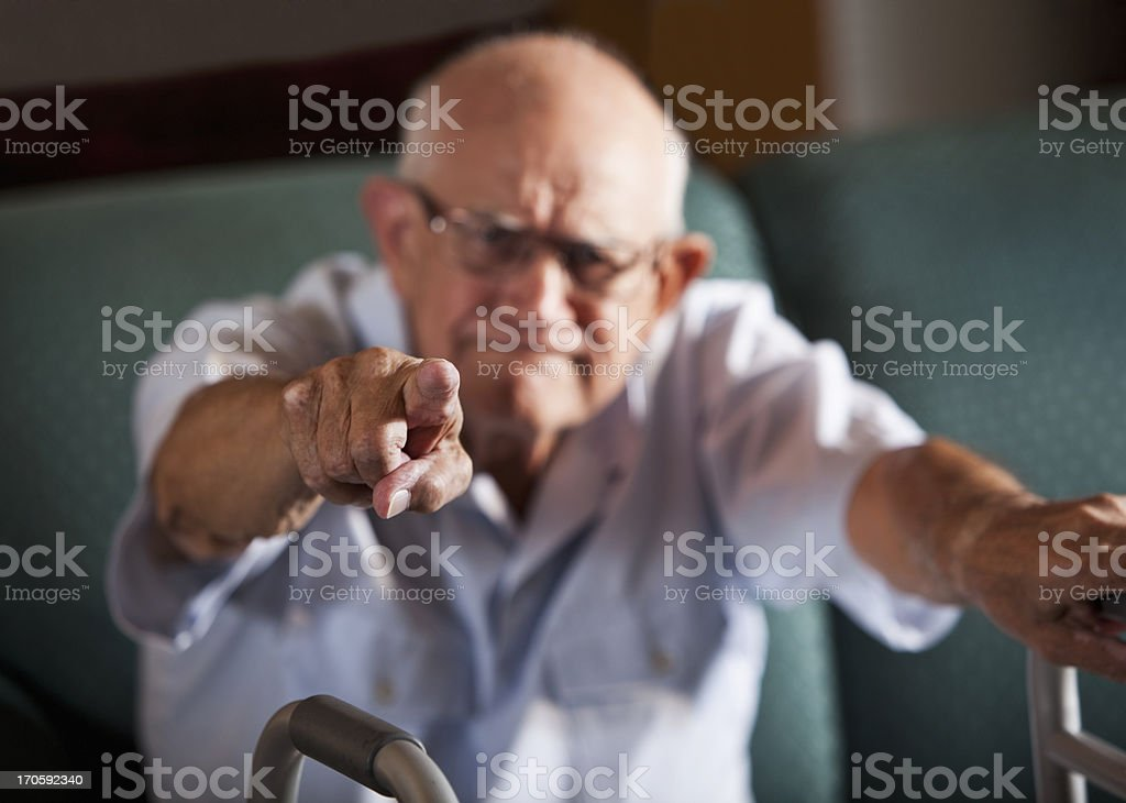 Senior man pointing stock photo