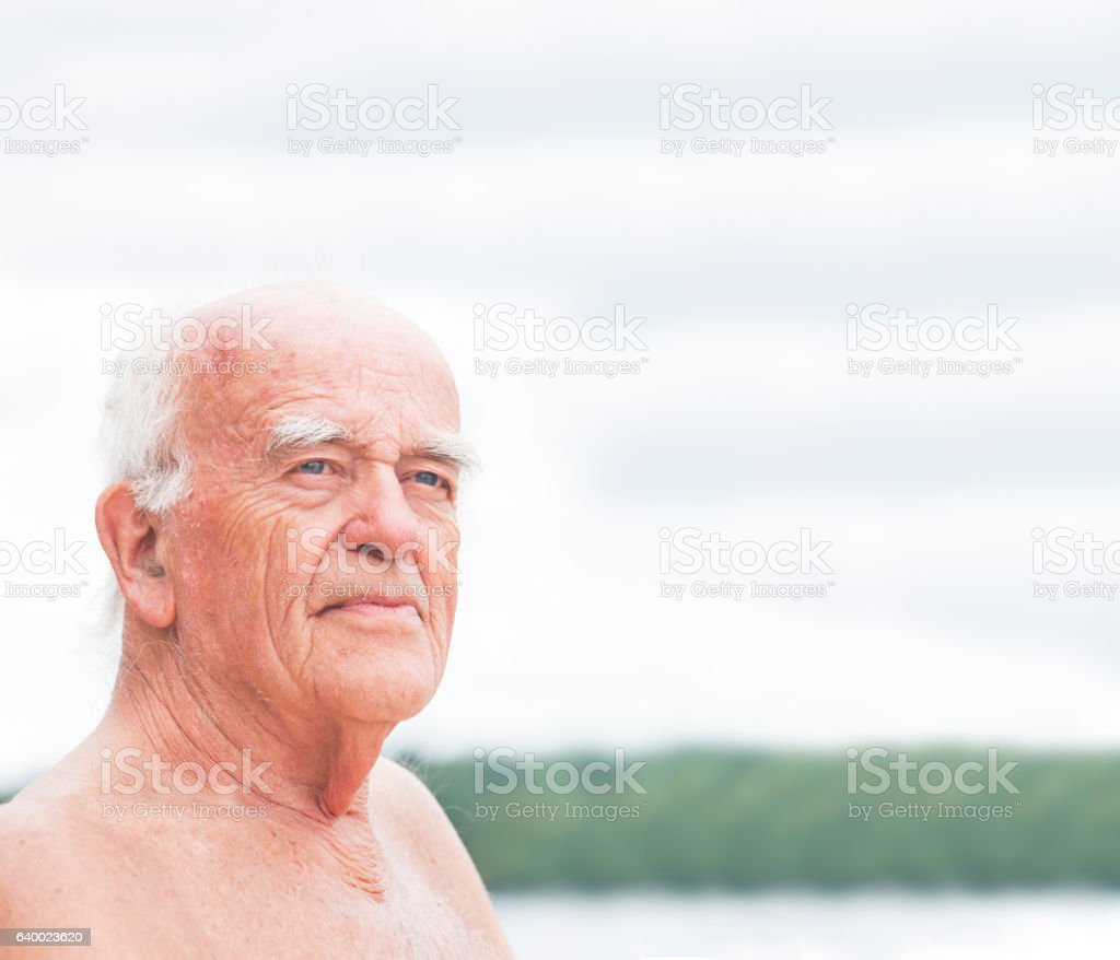 Senior man portrait at the lake stock photo