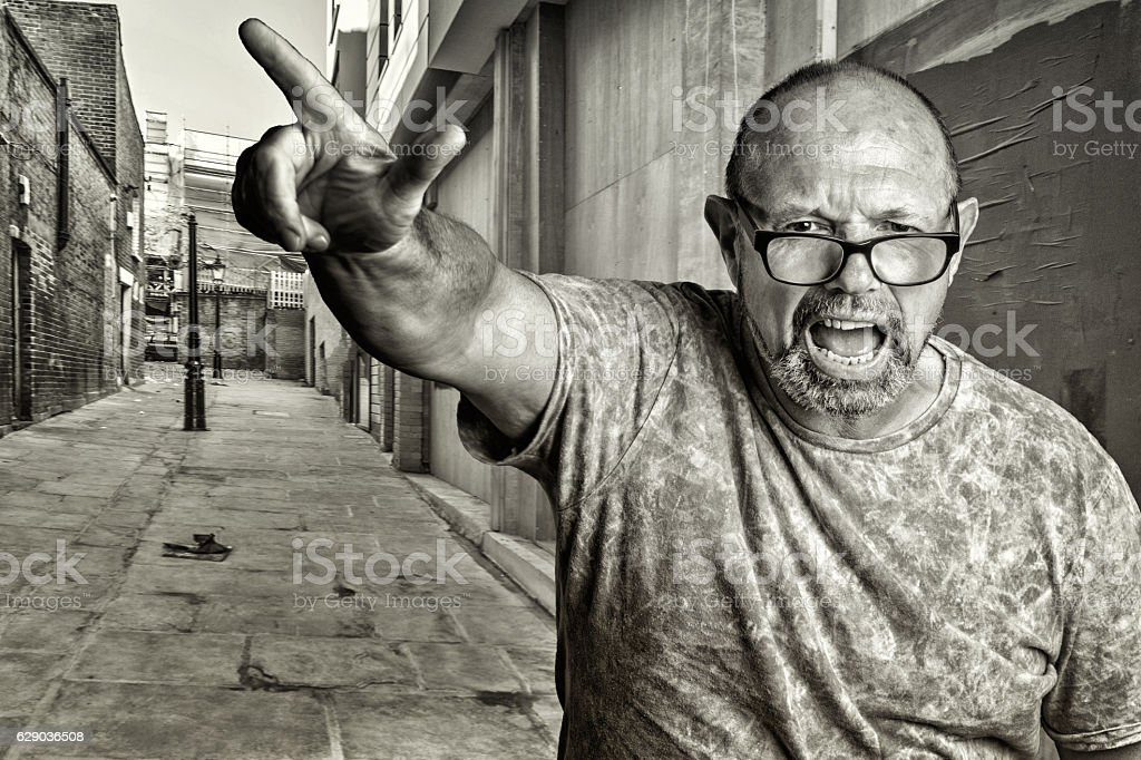 Senior man portrait pointing and ranting stock photo