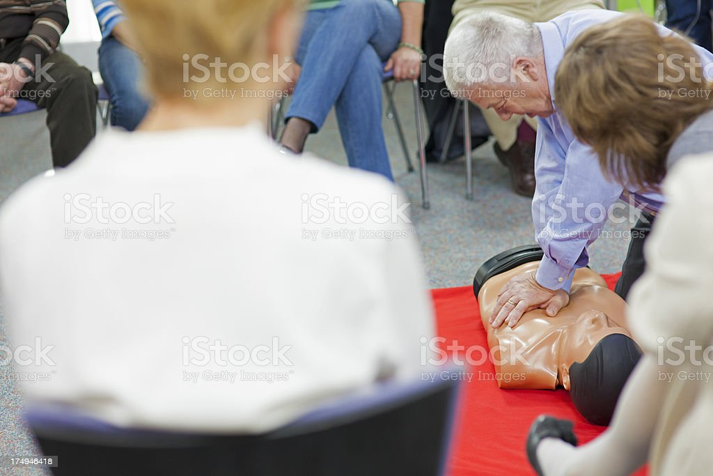 Senior Man Practicing Chest Compressions royalty-free stock photo