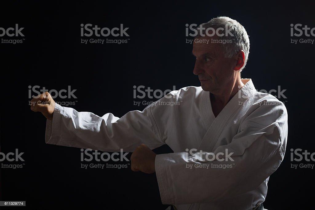 Senior man practicing karate stock photo