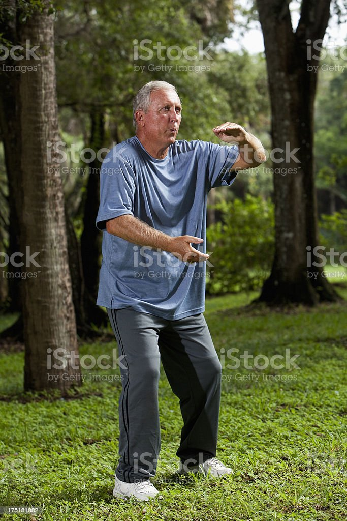 Senior man practicing tai chi stock photo