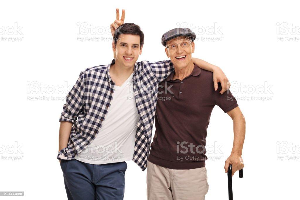 Senior man pranking his grandson stock photo