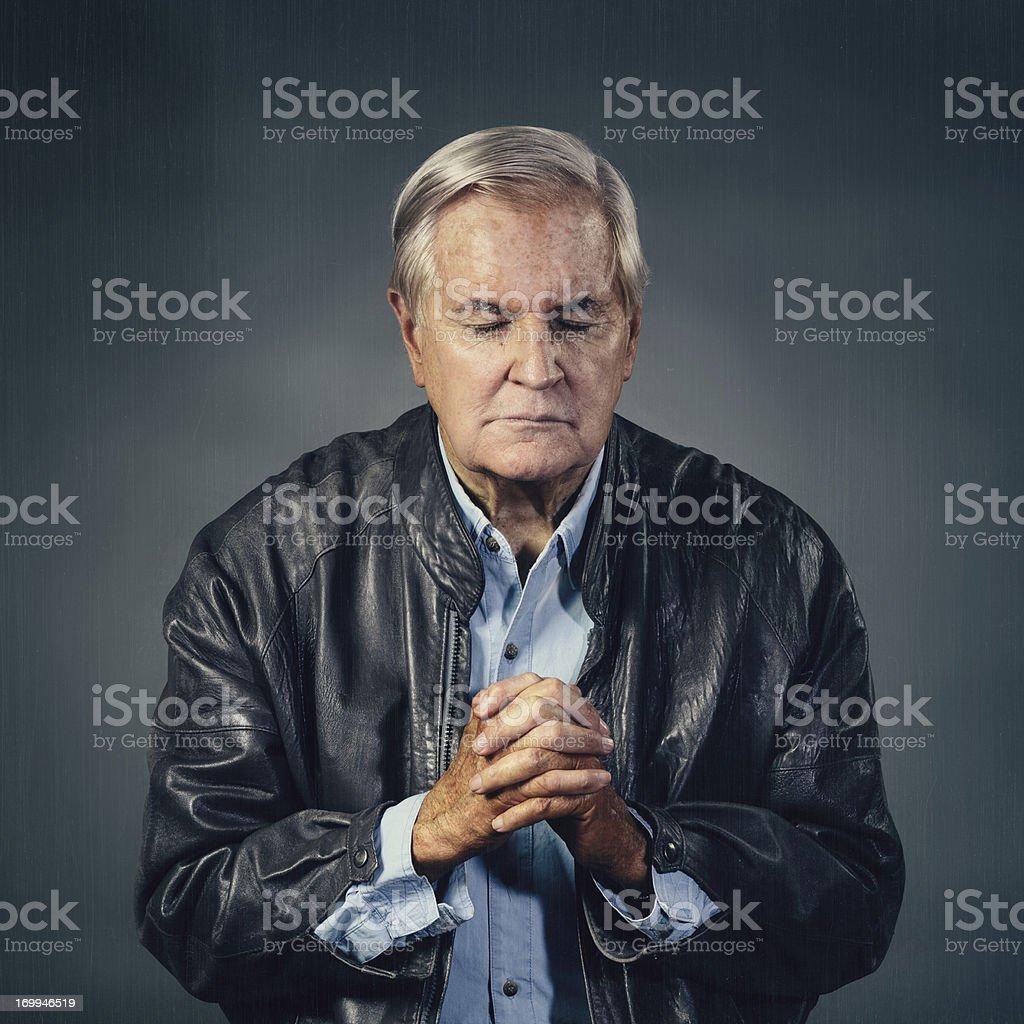 senior man praying stock photo