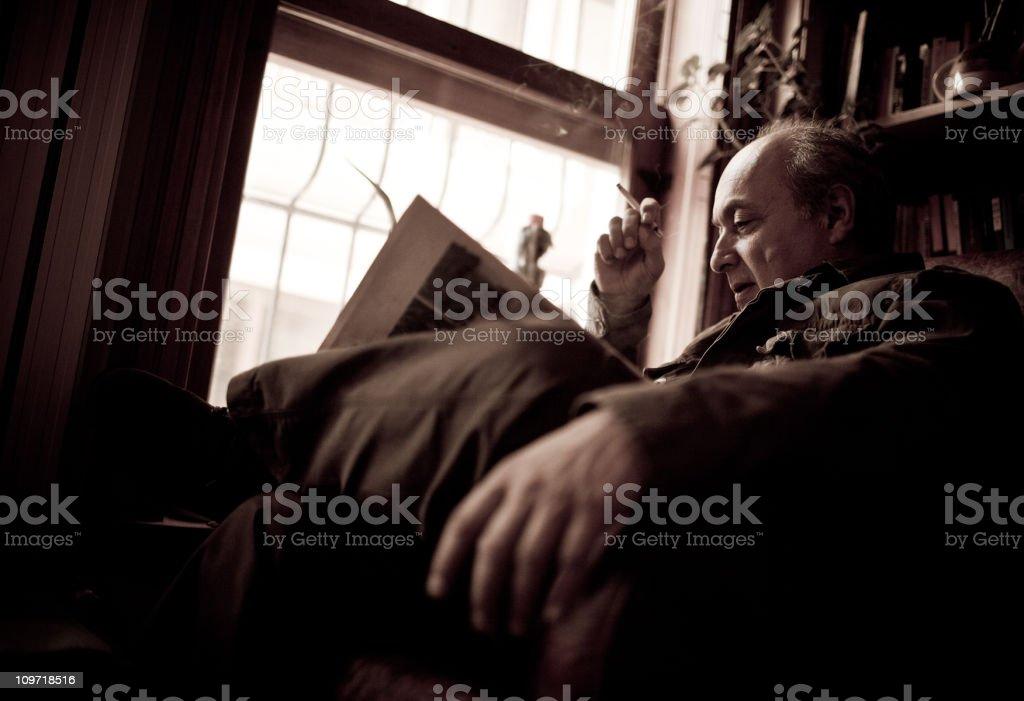 senior man reading a book royalty-free stock photo