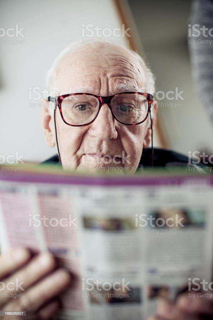 Senior man reading a Magazine royalty-free stock photo