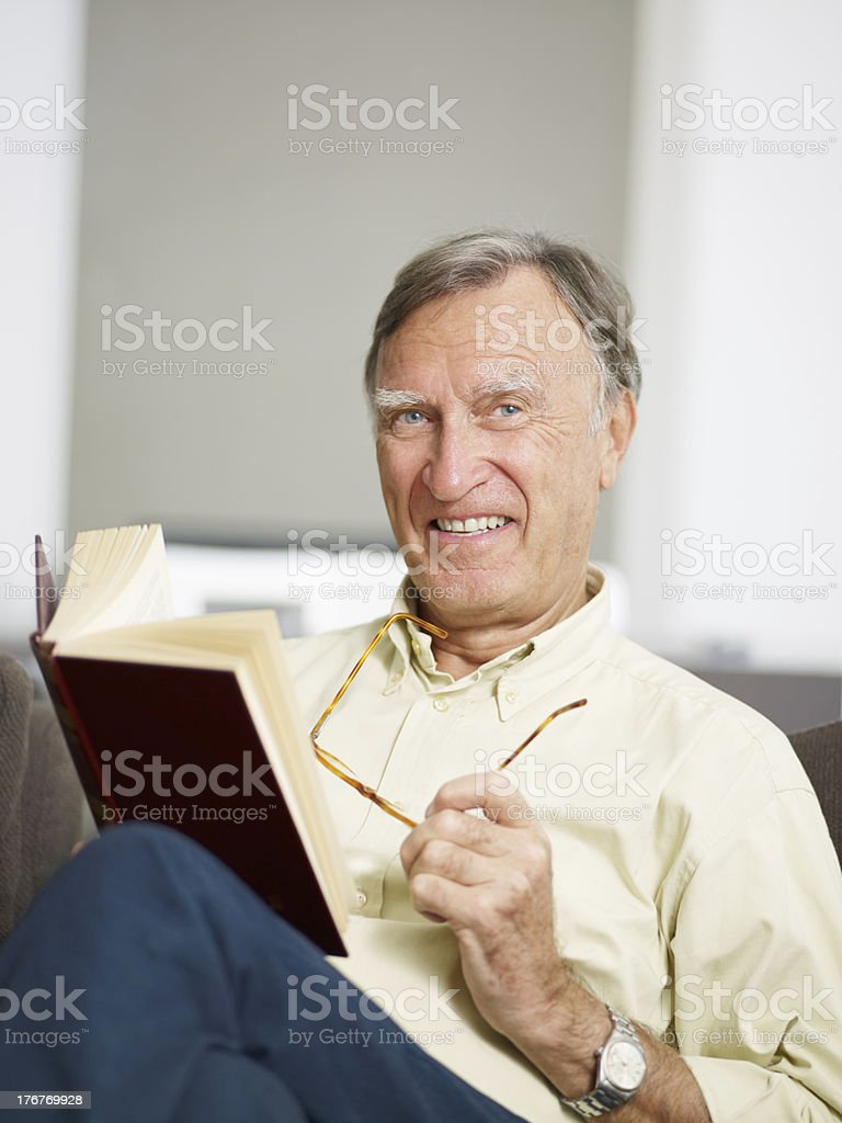 senior man reading book royalty-free stock photo