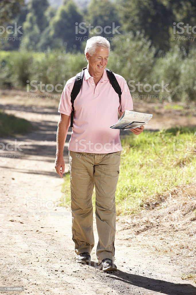 Senior man reading map on country walk royalty-free stock photo
