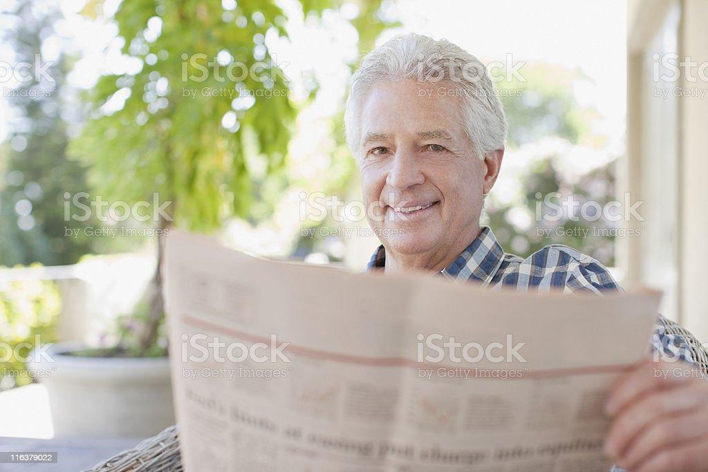 Senior man reading newspaper royalty-free stock photo
