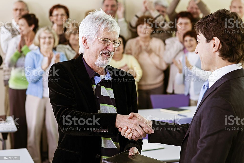 Senior  man receiving an award stock photo