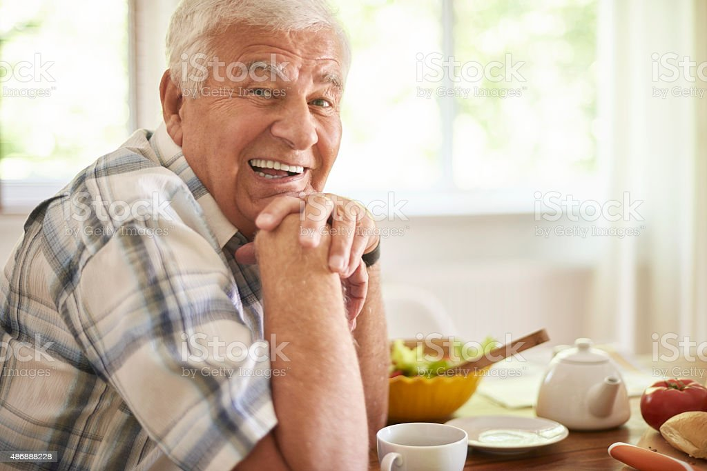 Senior man relaxing after breakfast stock photo