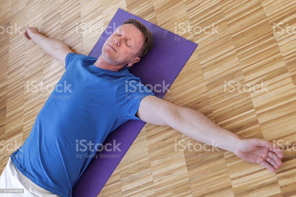 Senior man relaxing after yoga class royalty-free stock photo