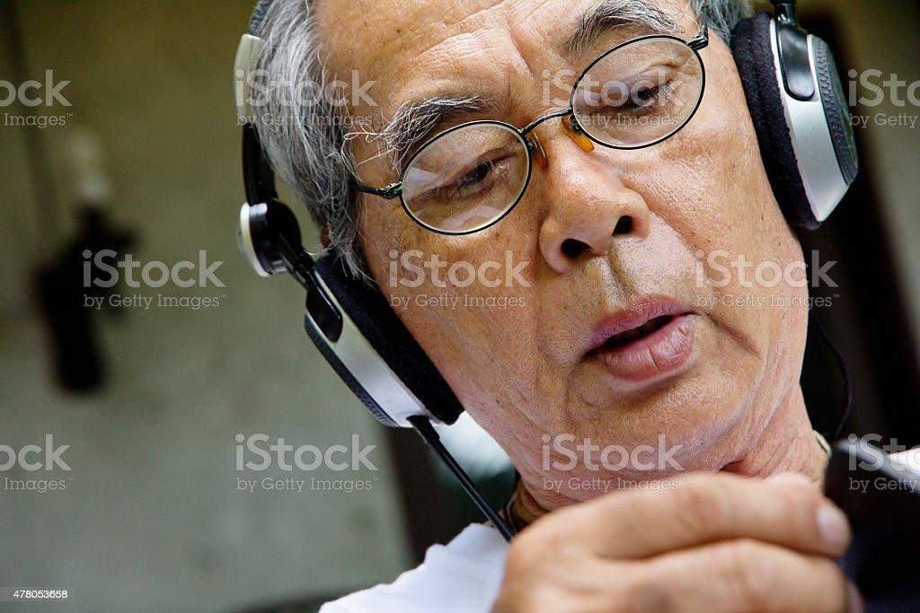 Senior man relaxing at home stock photo