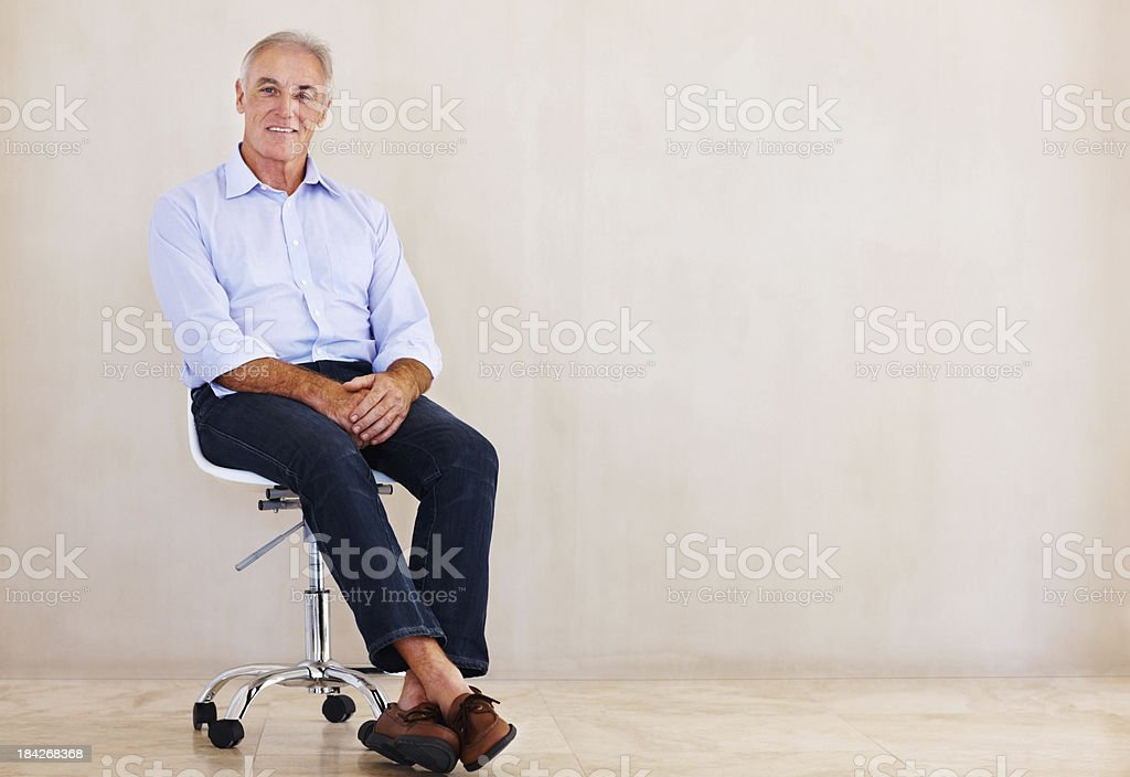 Senior man relaxing in a chair royalty-free stock photo