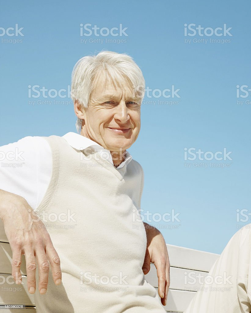 Senior man relaxing on a bench royalty-free stock photo