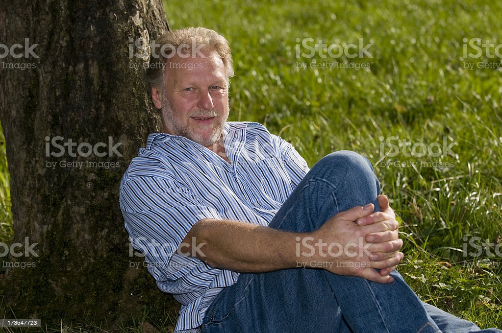 senior man relaxing outside royalty-free stock photo