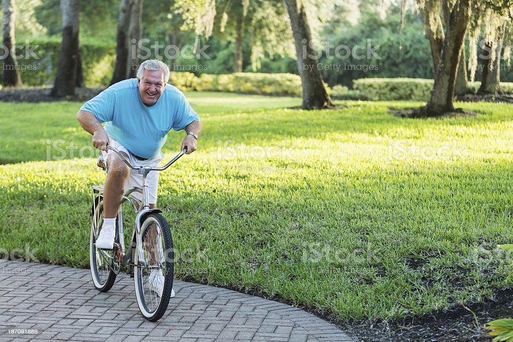 Senior man riding bicycle royalty-free stock photo