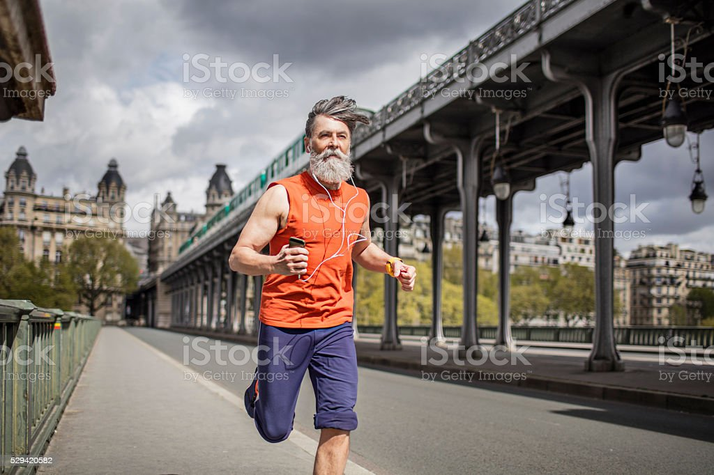Senior man running in the city stock photo
