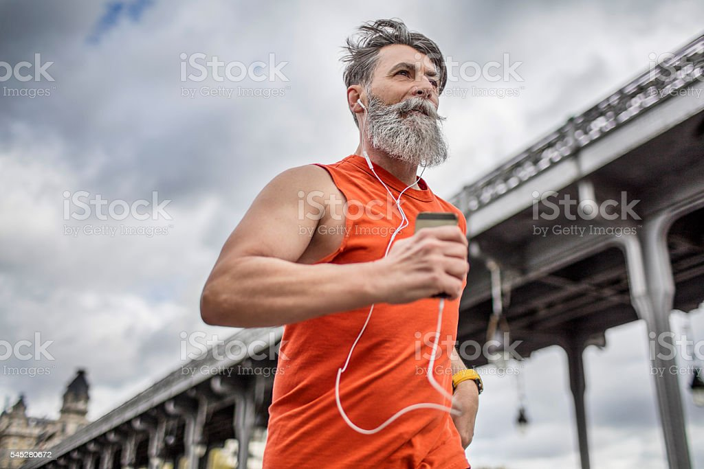 Senior man running in the city stock photo